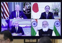 Joe Biden (top left), Yoshihide Sug (top right), Scott Morrison (bottom left), and Narendra Modi, during the virtual Quadrilateral Security Dialogue (Quad) meeting, on 12 March 2021 | Bloomberg