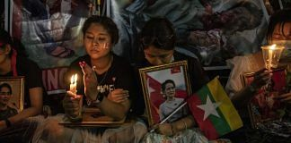 A demonstrator holds an image of Aung San Suu Kyi during a protest outside the UN Building in Bangkok on 4 March | Representational image | Photo: Andre Malerba | Bloomberg