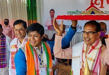 Madhya Pradesh Chief Minister and BJP leader Shivraj Singh Chouhan with Assam CM Sarbananda Sonowal during an election campaign rally at Naharkatia in Dibrugarh district, Monday, March 15, 2021.   PTI