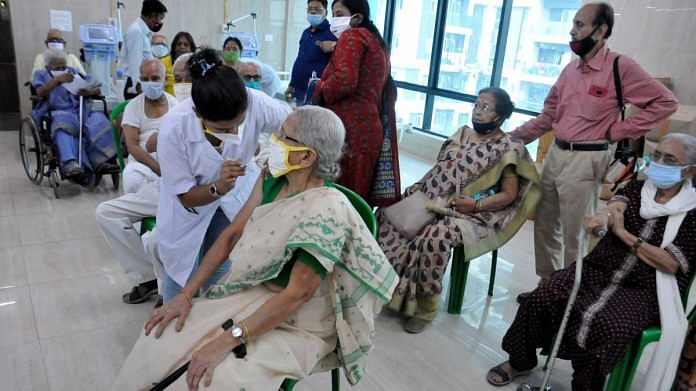 A medic administers Covid-19 vaccine to an elderly woman as other senior citizens wait, at Mayors Health Clinic in Kolkata | Representational image | 23 March 2021 | PTI