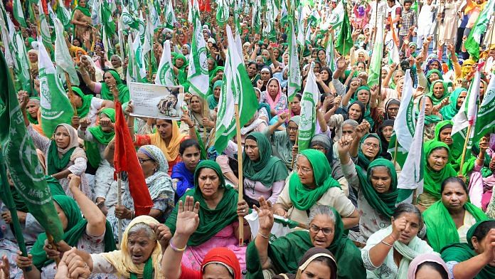 Women from Punjab and Haryana participate in farmers' protest on International Women's Day, at Tikri Border in Delhi, on 8 March 2021 | PTI Photo