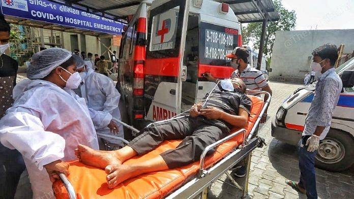 A Covid patient being taken in an ambulance in Ahmedabad, Gujarat   Praveen Jain   ThePrint