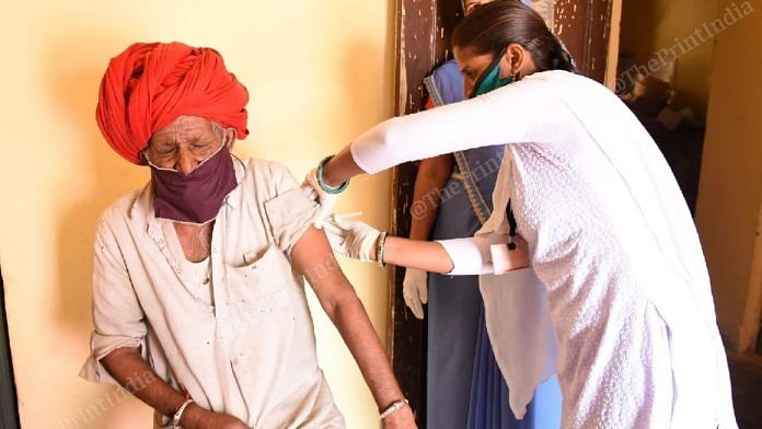 A resident of Jalindri getting the second dose of Covishield at a vaccination centre. | Photo: Rohit Jain Paras/ThePrint