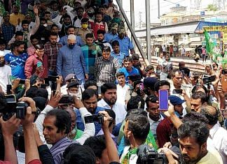 AIMIM chief Asaduddin Owaisi is welcomed by supporters at Sagardighi Railway Station in Murshidabad, in March 2021 | ANI
