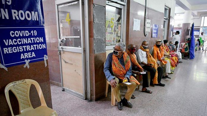 Representational image of people waiting for Covid-19 vaccine registration in New Delhi | Photo: ANI