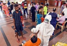 Medics collect swab samples of passengers for Covid tests at Kopar Khairane Railway Station in Navi Mumbai on 5 April 2021. | PTI