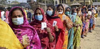 Women stand in a queue to cast their vote at a polling station during the 5th phase of State Assembly elections at Santipur, in Nadia   PTI
