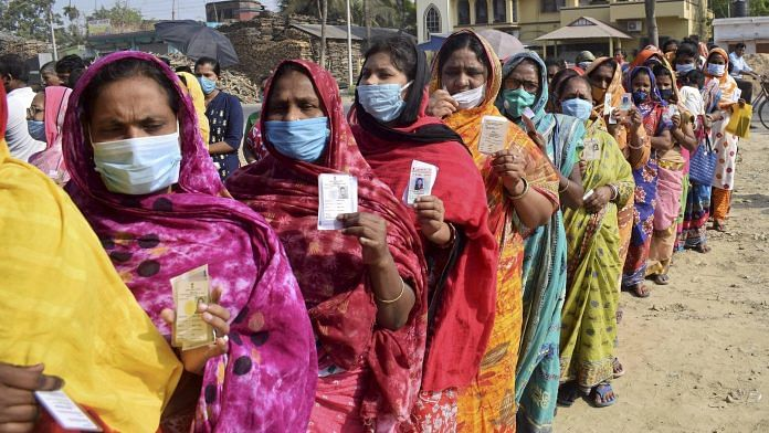 Women stand in a queue to cast their vote at a polling station during the 5th phase of State Assembly elections at Santipur, in Nadia | PTI