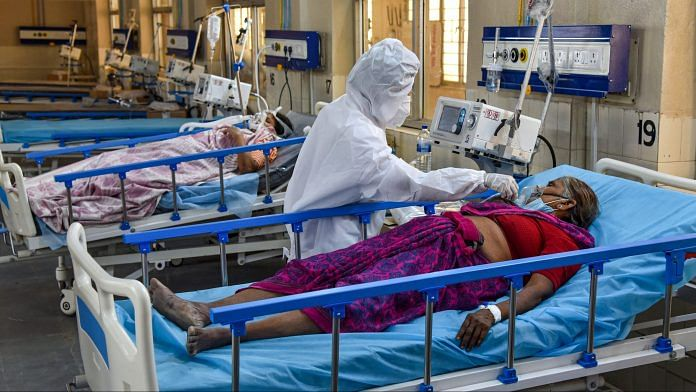 A health worker wearing PPE, attends to Covid-19 patients at a new 100 beds ICU COVID Ward with Oxygen and Ventilator facilities in Hyderabad on April 27, 2021 | PTI