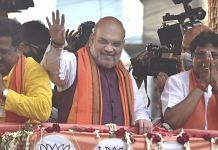 Union Home Minister Amit Shah during a roadshow in support of BJP candidates ahead of the 3rd phase of West Bengal Assembly polls at Baruipur Paschim in South 24 Parganas, on 2 April 2021   PTI