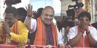 Union Home Minister Amit Shah during a roadshow in support of BJP candidates ahead of the 3rd phase of West Bengal Assembly polls at Baruipur Paschim in South 24 Parganas, on 2 April 2021 | PTI
