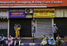 People wait outside a Covid-19 vaccination centre in Kolkata, India, on Wednesday, April 28, 2021. | Photographer: Arko Datto | Bloomberg