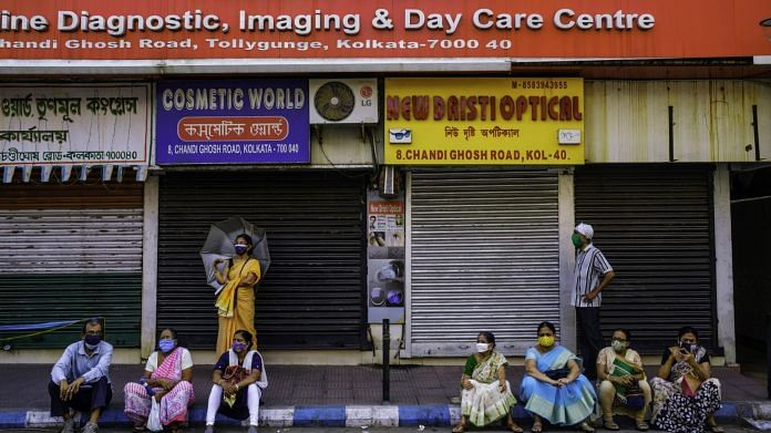 People wait outside a Covid-19 vaccination centre in Kolkata, India, on Wednesday, April 28, 2021.   Photographer: Arko Datto   Bloomberg