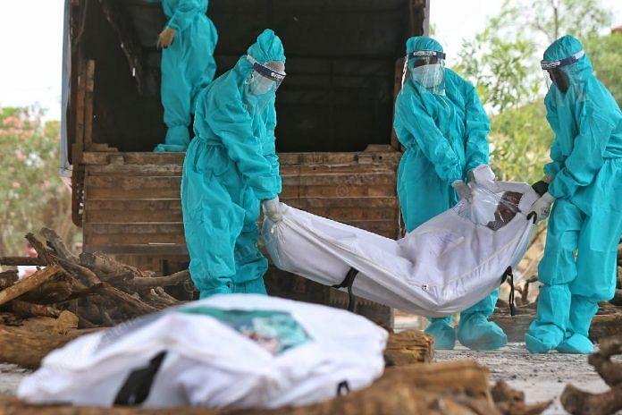 Representational Image | Dead bodies of Covid patients being taken for last rites | Suraj Singh Bisht | ThePrint