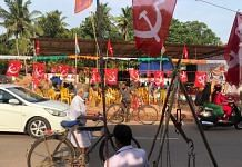 CPM flags flutter in Choonadu village ahead of Kerala Finance Minister Thomas Isaac's address at a roadside meeting. | Photo: Jyoti Malhotra/ThePrint