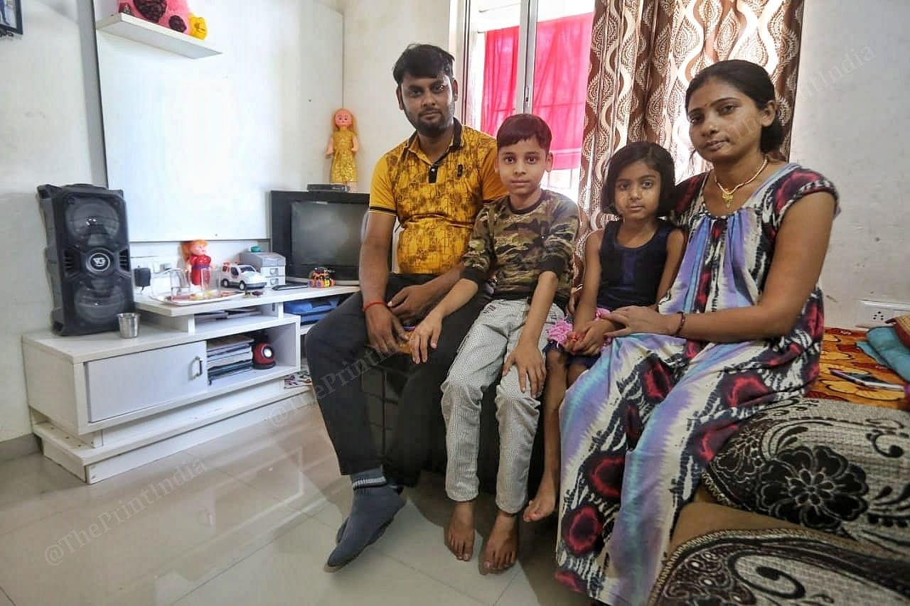 Abhay Singh and his family in their apartment in the GIFT City. | Photo: Praveen Jain/ThePrint