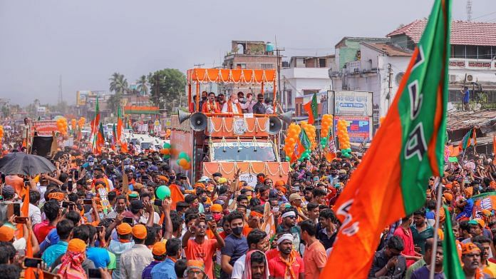 Home Minister Amit Shah during a roadshow at Bethuadahari in West Bengal's Nadia district, on 18 April 2021 | PTI Photo