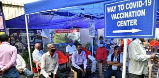 Representational image | People wait for their turn to get the first dose of the Covid-19 vaccine | ANI