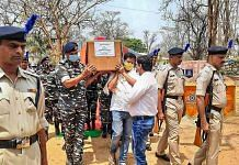 CRPF personnel carry the coffin of a jawan who was killed in the attack by Maoists, in Bijapur district of Chhattisgarh, on 4 April 2021 | PTI