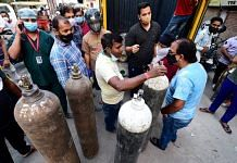 People in New Delhi enquire about availability of cylinders of medical oxygen, required for treatment of critical Covid-19 patients, as coronavirus cases surge across the country, on 21 April 2021 | Kamal Kishore | PTI