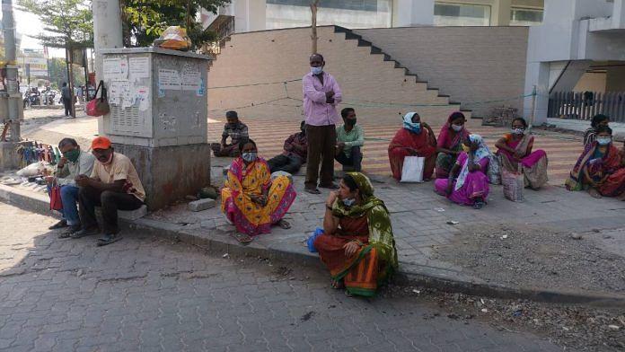 Migrant workers wait for contractors at Ganraj Chowk in Pune | Angana Chakrabarti | ThePrint