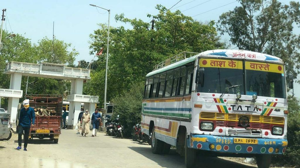 A bus turned into a hearse stands outside Gulala crematorium in Lucknow | Photo: Jyoti Yadav | ThePrint