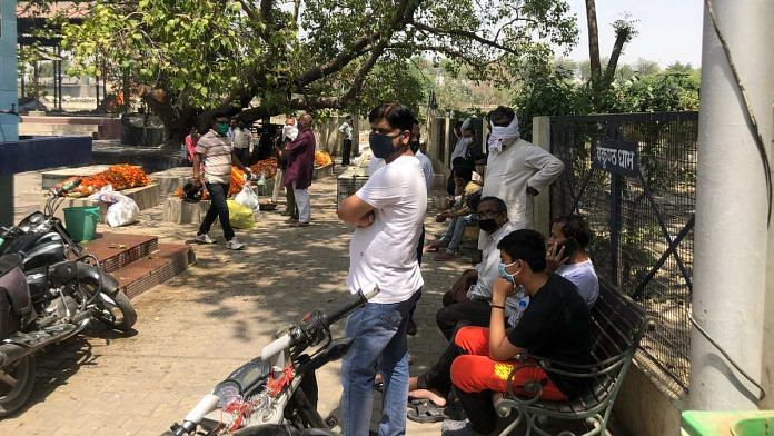 Families await their turn to cremate Covid-19 patients' bodies at Baikunth Dham crematorium in Lucknow | Photo: Jyoti Yadav | ThePrint