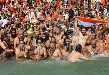 Devotees gather to offer prayers during the third 'Shahi Snan' of the Kumbh Mela 2021, in Haridwar, 14 April 2021 | PTI