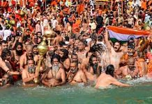 Devotees gather to offer prayers during the third Shahi Snan of the Kumbh Mela 2021, at Har ki Pauri Ghat in Haridwar on 14 April | PTI
