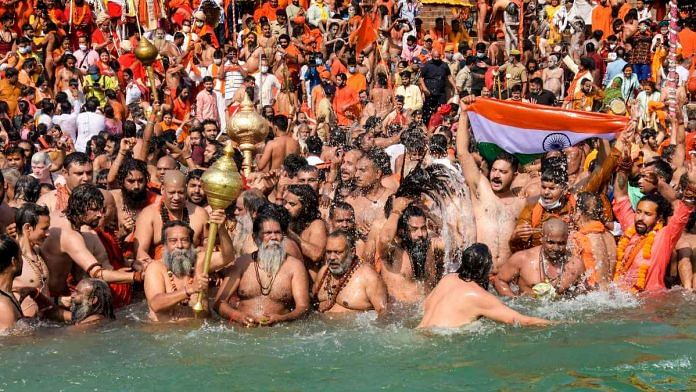 Devotees gather to offer prayers during the third Shahi Snan of the Kumbh Mela 2021, at Har ki Pauri Ghat in Haridwar on 14 April   PTI