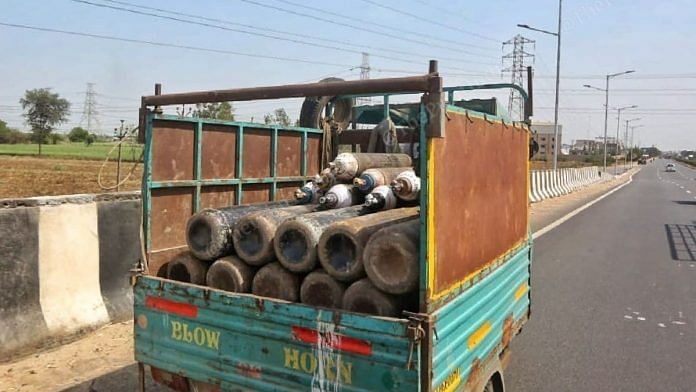 A tempo carries oxygen cylinders on the Ahmedabad-Surat Highway | Representational image | Praveen Jain | ThePrint