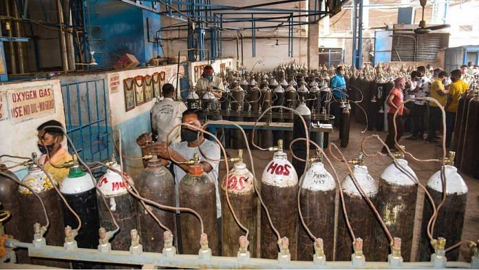 Workers refill cylinders with medical oxygen, in Patna, on 27 April 2021 | PTI