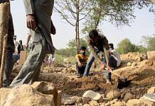Staff at Delhi's Qabristan Ahle Islam dig a grave for a Covid patient Thursday   Tenzin Zompa   ThePrint