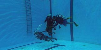 Man in wheelchair (centre) trains for scuba diving with CLAW | Photo by special arrangement