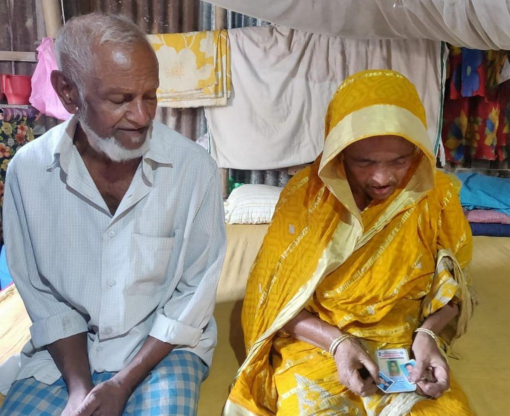 Faizal Vyapari and his wife Sabar Bano, who is holding photos of their three sons who all died by suicide | Photo: Fatima Khan | ThePrint