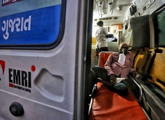 Patient wearing oxygen masks inside the ambulance | Photo: Praveen Jain | ThePrint
