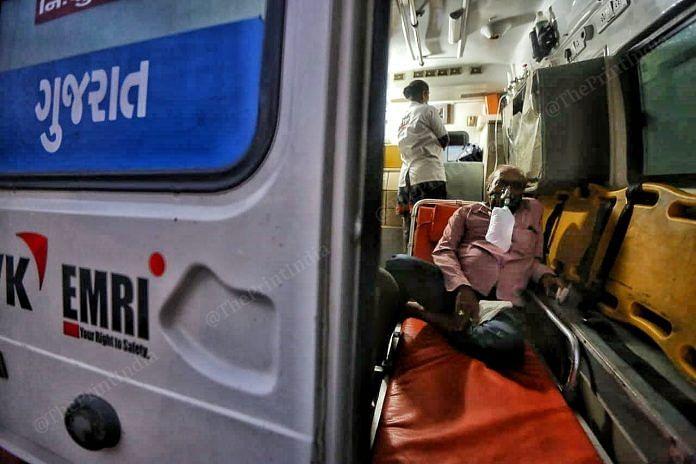 Patient wearing oxygen masks inside the ambulance   Photo: Praveen Jain   ThePrint