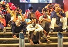 A group of migrant workers from Bihar waits at a railway station   Representational image   Photo: Praveen Jain   ThePrint
