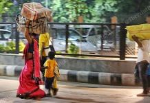 A family of migrant workers walks towards the railway station   Photo: Praveen Jain   ThePrint