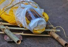 Plastic memories, a Covid patient wrapped and taped in plastic brought to Ellisbridge for his last rituals | Photo: Praveen Jain | ThePrint
