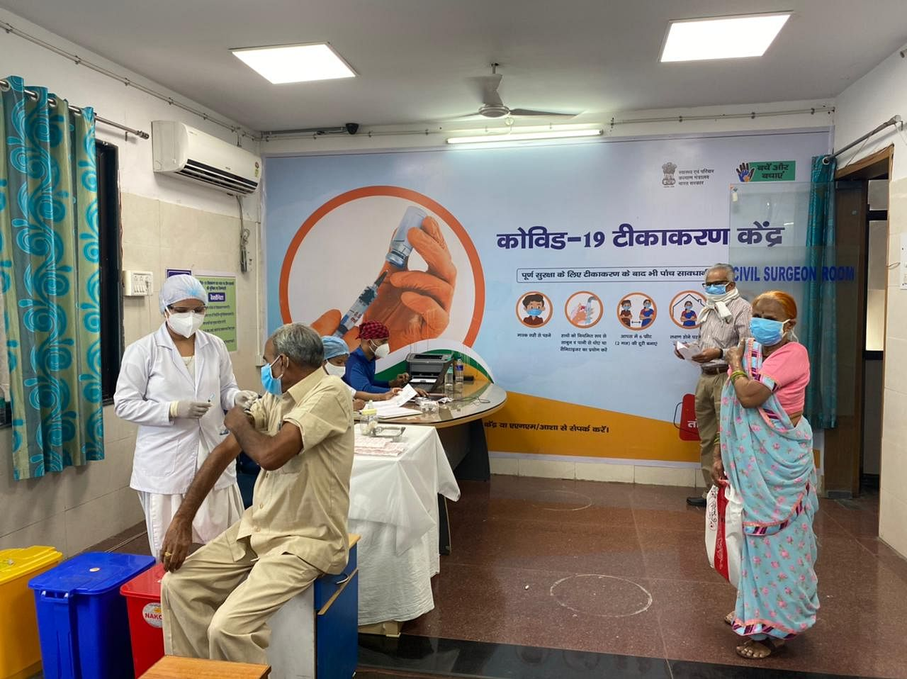 An elderly couple gets their second vaccine dose in Bhopal | Revathi Krishnan | ThePrint