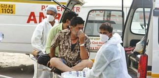 A Covid patient is offered medical support outside the New Civil Hospital of Surat | Soniya Agrawal | ThePrint