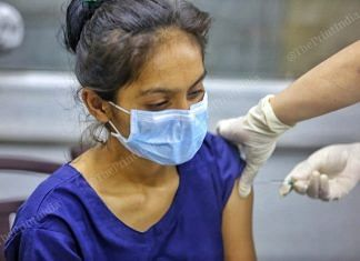A woman getting Covid vaccine shot