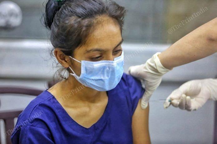 A healthcare worker in Ahmedabad gets her shots | Representational image | Photo: Praveen Jain | ThePrint