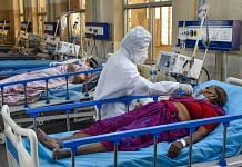 A health worker attends to Covid-19 patients at a Covid ICU Ward in Hyderabad, on 27 April 2021 | PTI Photo