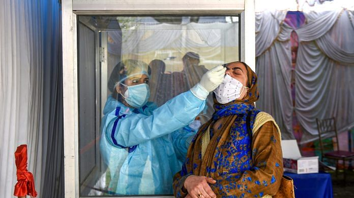 A health worker conducts Covid-19 test in Srinagar on 6 April 2021 | PTI Photo