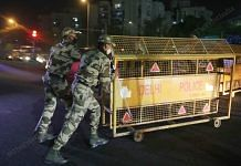 Security personnel during night curfew in New Delhi on 13 April 2021