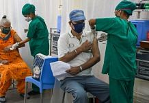 A BMC medical staff administers a dose of Covid-19 vaccine to a beneficiary at Nair hospital in Mumbai, on 27 April 2021 | PTI