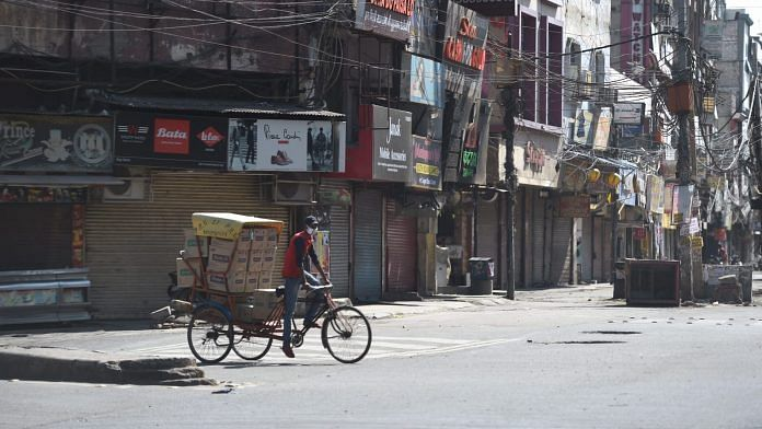 Closed shops at Vikas Marg, during weekend lockdown imposed in the wake of rising Covid-19 cases across the country, in New Delhi, Saturday, 17 April, 2021. | PTI