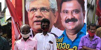 Voters in Peyyad Junction in Thiruvananthapuram stand in front of a hoarding of CPM general secretary Sitaram Yechury and CPM candidate I B Satheesh | Photo: Jyoti Malhotra | ThePrint